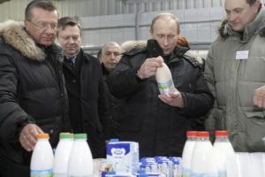 Russia's then Prime Minister Vladimir Putin inspects the production as he visits a dairy factory in Leningrad region
