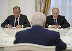 Russian President Vladimir Putin (R), Foreign Minister Sergei Lavrov (L) and Syrian Foreign Minister Walid al-Muallem (back to camera) attend a meeting at the Kremlin in Moscow, Russia, June 29, 2015.  REUTERS/Alexei Nikolsky/RIA Novosti/Kremlin