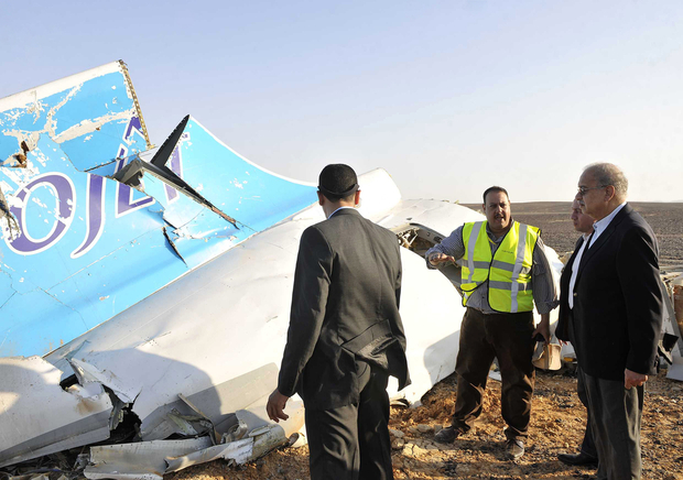 "A handout picture released by Egypt's Prime Minister's office on October 31, 2015, shows PM Sherif Ismail (R) at the site of the wreckage of a crashed A321 Russian airliner in Hassana a mountainous area of Egypt's Sinai Peninsula. The Airbus A321, flight 9268, with 214 Russian and three Ukrainian passengers and seven crew, had taken off from the Red Sea resort of Sharm el-Sheikh in south Sinai bound for Saint Petersburg, it lost contact with air traffic control 23 minutes later , crashing in Egypt's Sinai Peninsula killing everyone on board. AFP PHOTO / HO / SELIMAN AL-OTEIFI / EGYPTIAN PRIME MINISTER'S OFFICE === RESTRICTED TO EDITORIAL USE - MANDATORY CREDIT ""AFP PHOTO / HO / EGYPTIAN PRIME MINISTER'S OFFICE"" - NO MARKETING NO ADVERTISING CAMPAIGNS - DISTRIBUTED AS A SERVICE TO CLIENTS ==="