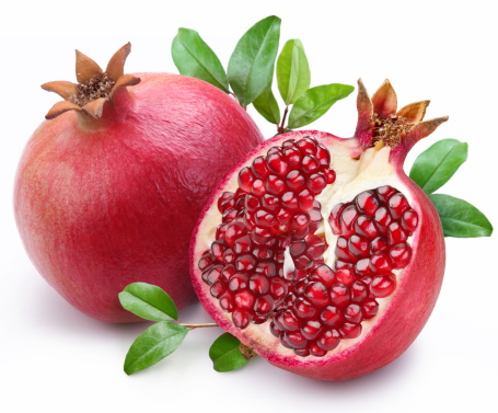 119503418-juicy-pomegranate-and-its-half-with-leaves