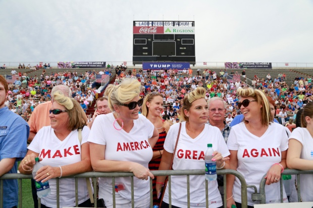 Supporters in coordinated shirts attend Donald Trump's campaign rally in Mobile, Ala.